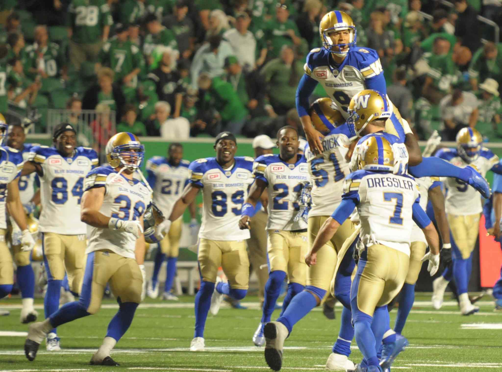 Winnipeg Blue Bombers kicker Justin Medlock celebrates his overtime winner to spoil the Saskatchewan Roughriders' home opener during CFL action at the brand new Mosaic Stadium, in Regina on Saturday, July 1, 2017.