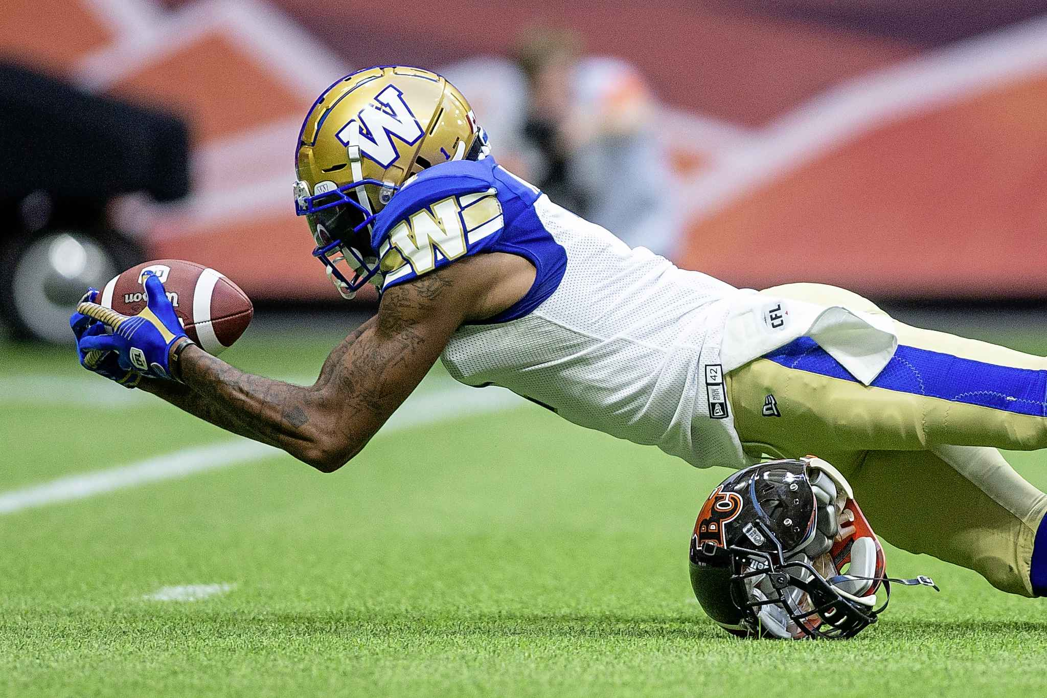 BEN NELMS / THE CANADIAN PRESS</p><p>Winnipeg Blue Bombers wide receiver Marvin Adams (1) dives with the ball after being tackled by B.C. Lions' T/J. Lee (6) during the first half.</p>