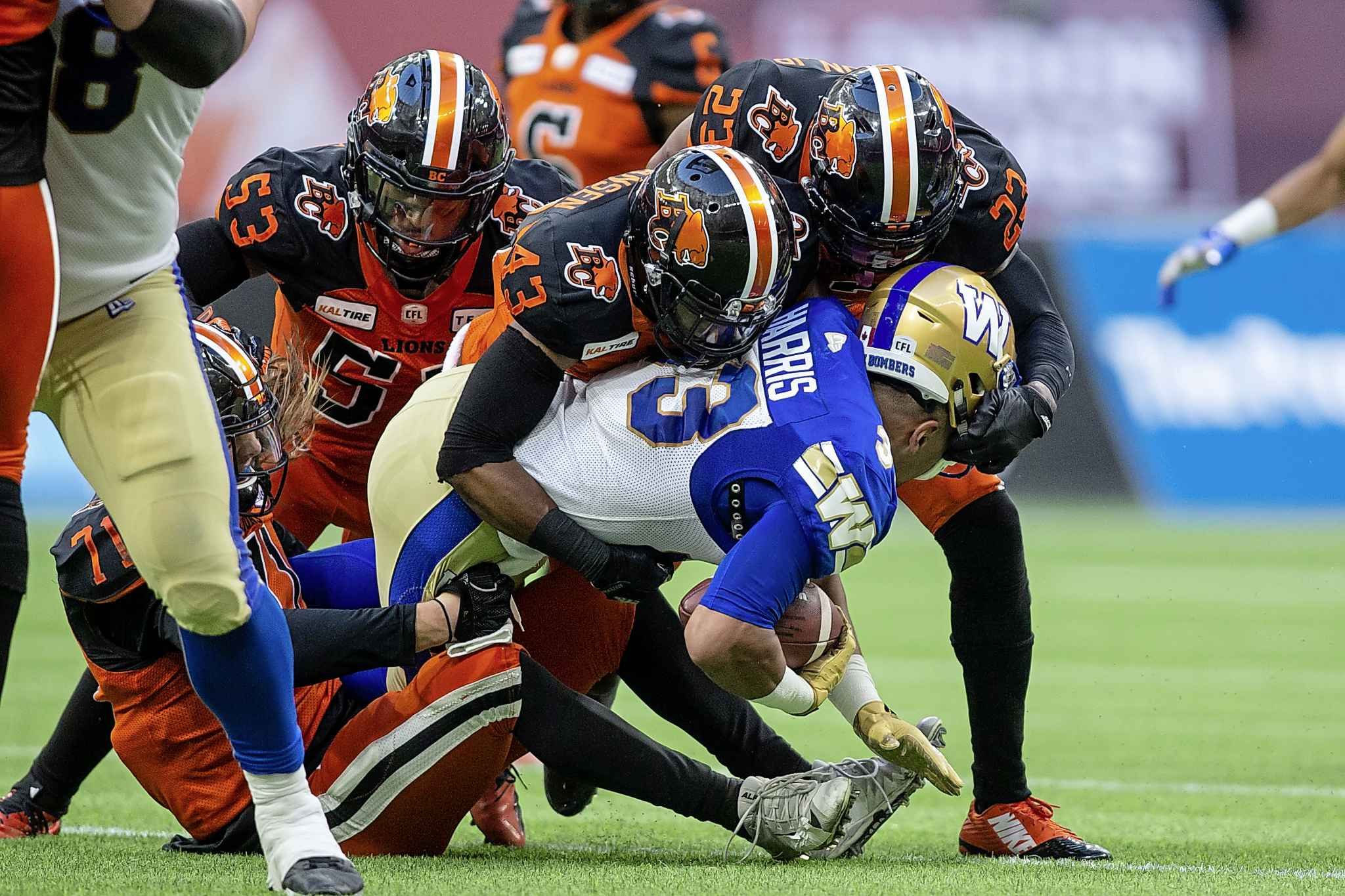 BEN NELMS / THE CANADIAN PRESS</p><p>Winnipeg Blue Bombers running back Andrew Harris (33) is tackled by B.C. Lions defensive back Dominique Termansen (43) during the first half.</p>