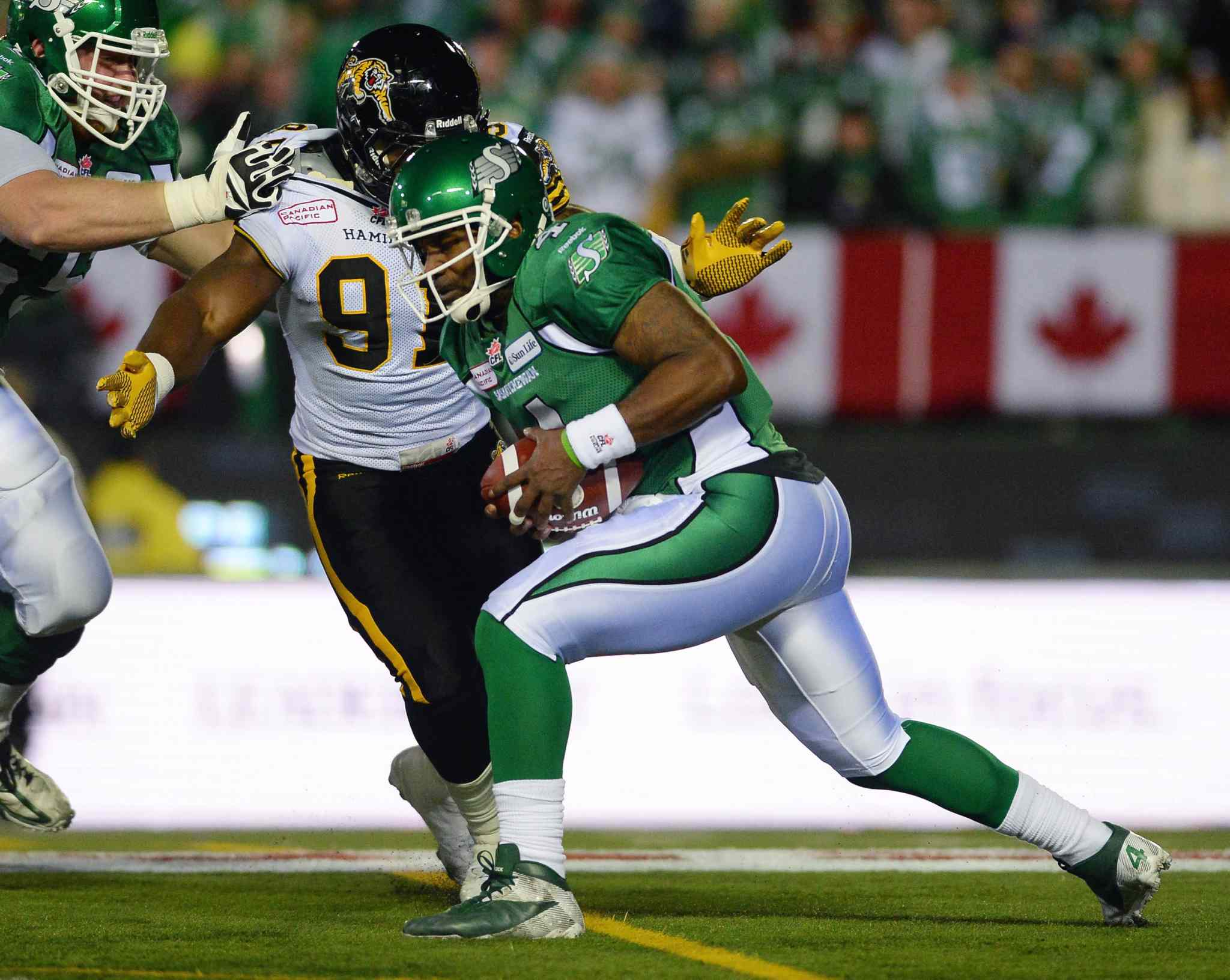 Saskatchewan Roughriders quarterback Darian Durant is tackled by Hamilton Tiger-Cats defensive lineman Brandon Boudreaux during the first quarter.