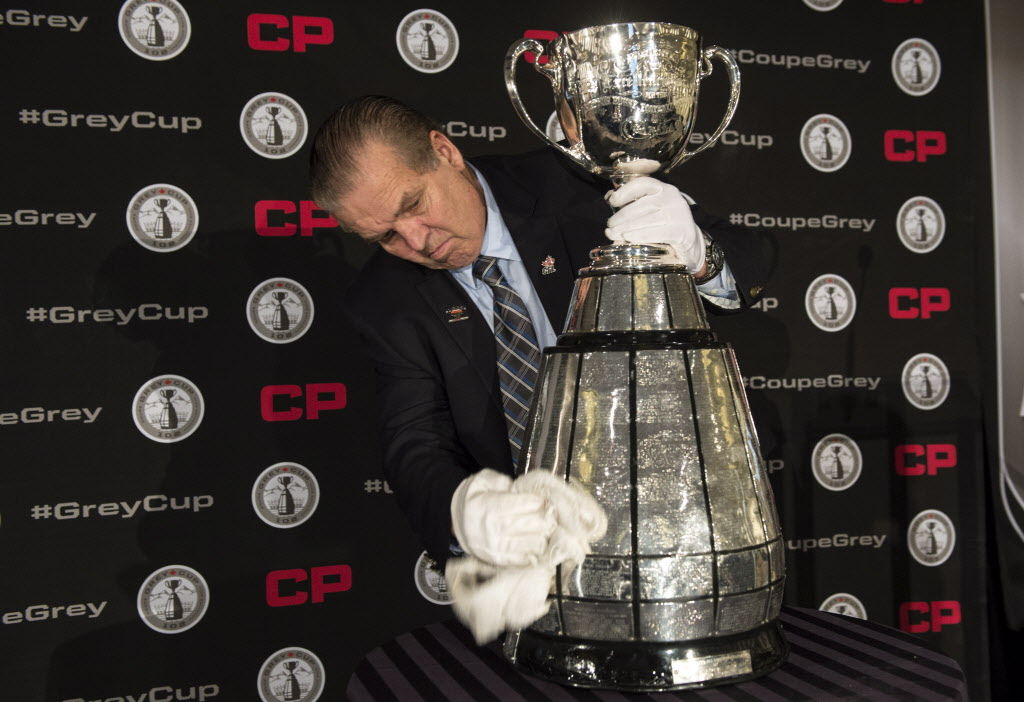 Grey Cup handler Dennis Dowell shines the Cup prior to a team lunch with the Calgary Stampeders in 2014 in Vancouver.