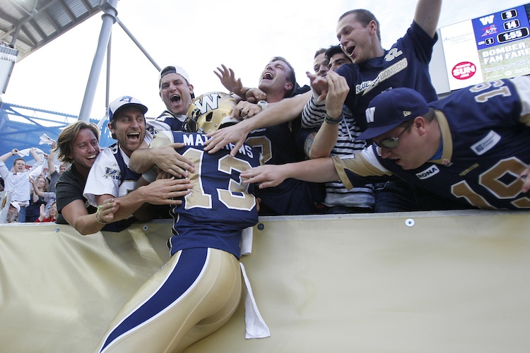 Winnipeg Blue Bombers' Chris Matthews (13) celebrates his touchdown against the Montreal Alouettes during the first half. (John Woods / The Canadian Press)