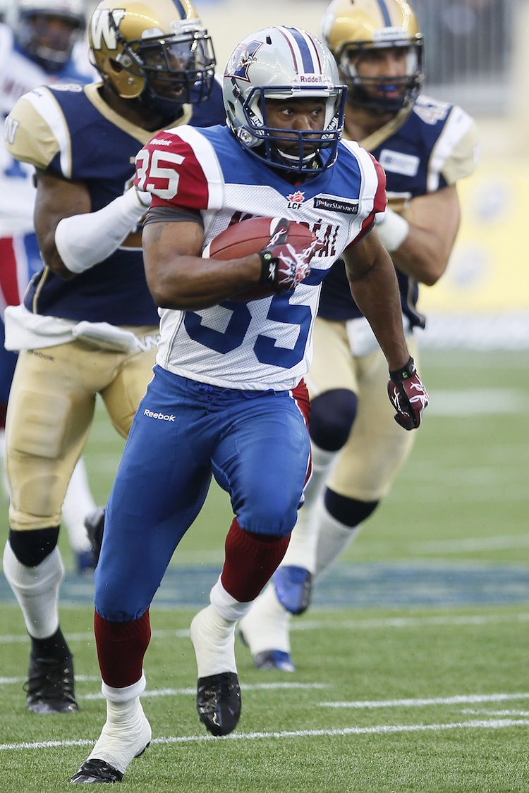 Montreal Alouettes' Tyron Carrier (35) returns a punt 78 yards for a touchdown during the first half. (John Woods / The Canadian Press)