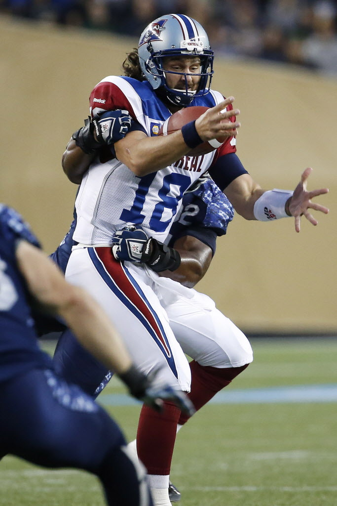 Montreal Alouettes' quarterback Jonathan Crompton (18) gets sacked by Winnipeg Blue Bombers' Bryant Turner (92). (John Woods / The Canadian Press)