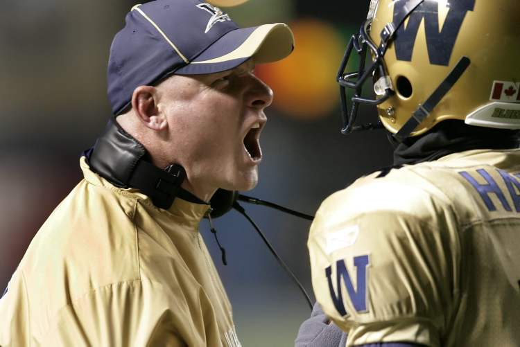 Winnipeg Blue Bombers head coach Paul LaPolice yells at Terence Jeffers-Harris (14) for showboating after scoring a touchdown against the Calgary Stampeders in a November 2010 match-up. The showboating earned the Winnipeg Blue Bombers a 15-yard penalty. (John Woods / The Canadian Press Archives)