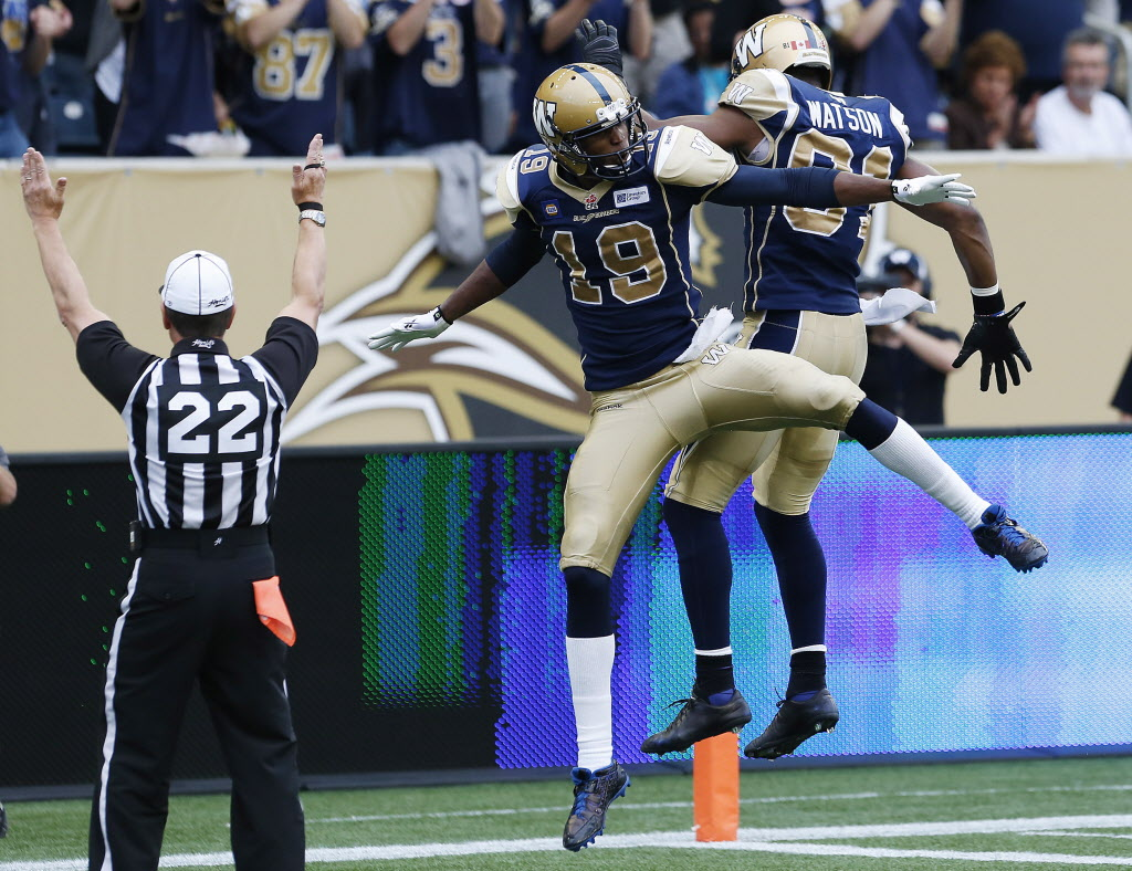 Winnipeg Blue Bombers' Aaron Kelly and Cory Watson celebrate Kelly's touchdown against the Toronto Argonauts.  (John Woods / THE CANADIAN PRESS)