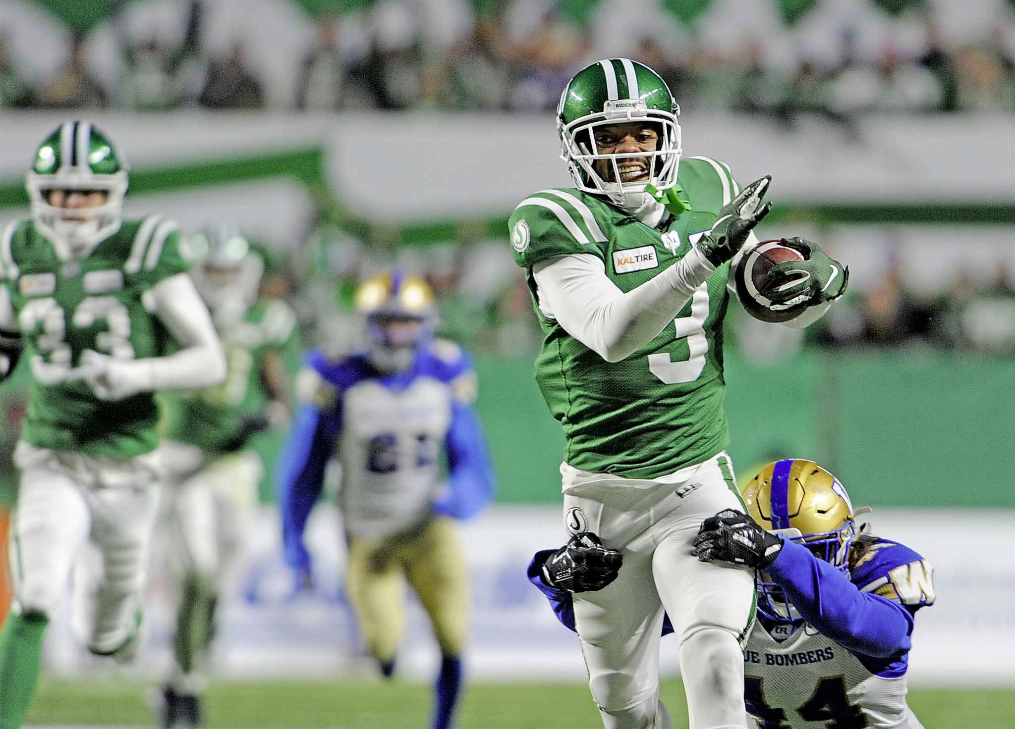 MARK TAYLOR / THE CANADIAN PRESS</p><p>Saskatchewan Roughriders defensive back Nick Marshall is brought down by Winnipeg Blue Bombers linebacker Shayne Gauthier.</p>