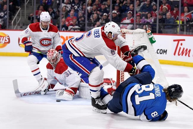 Winnipeg Jets' Kyle Connor (81) is checked by Montreal Canadiens' Shea Weber (6) after goaltender Carey Price (31) made the save on a breakaway during second period NHL action in Winnipeg on Monday Dec. 23, 2019. THE CANADIAN PRESS/Fred Greenslade