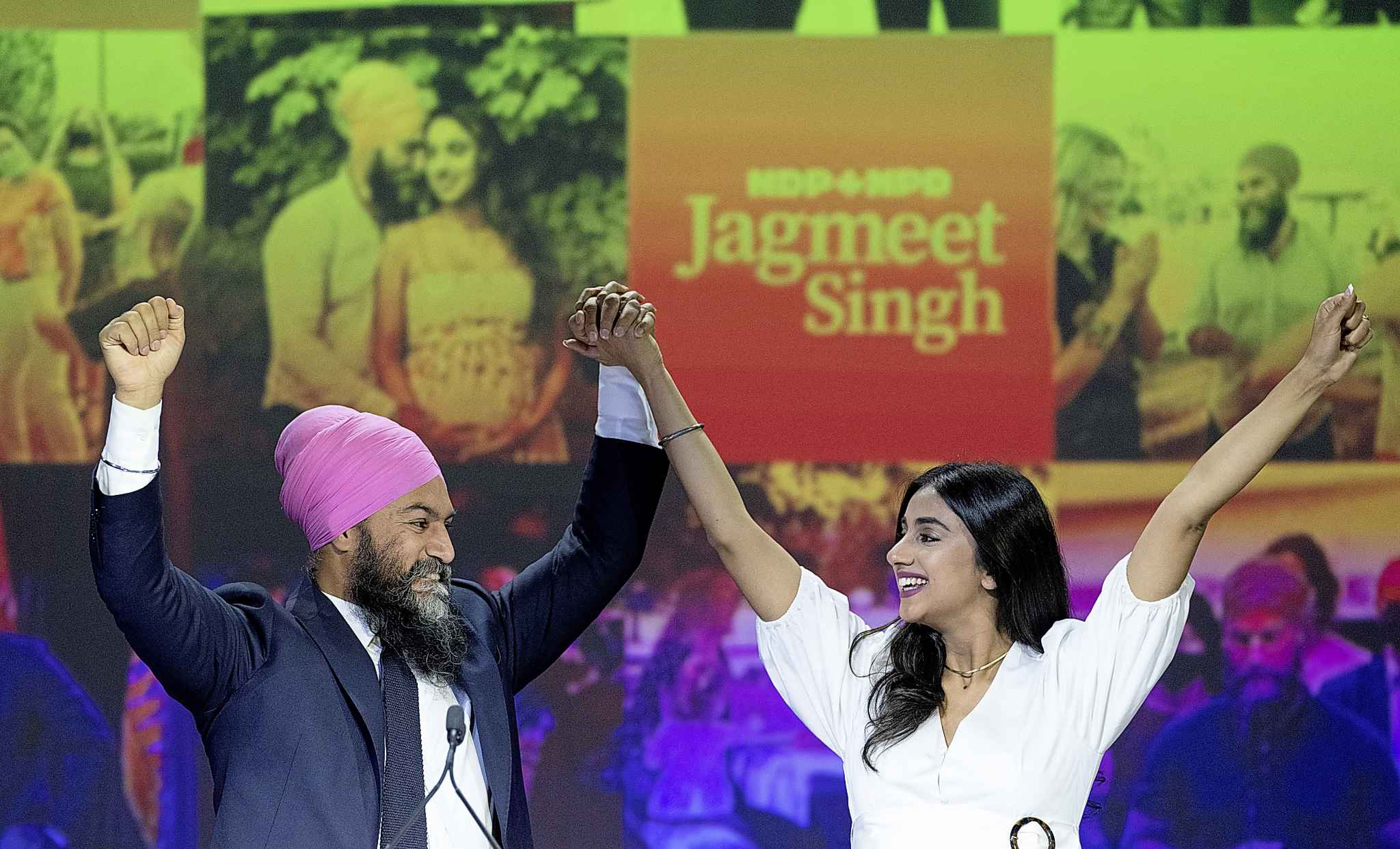 NDP Leader Jagmeet Singh and his wife Gurkiran Kaur Sidhu arrive on stage to deliver his concession speech at his election night headquarters during the Canadian federal election in Vancouver, Monday, September 20, 2021. THE CANADIAN PRESS/Jonathan Hayward