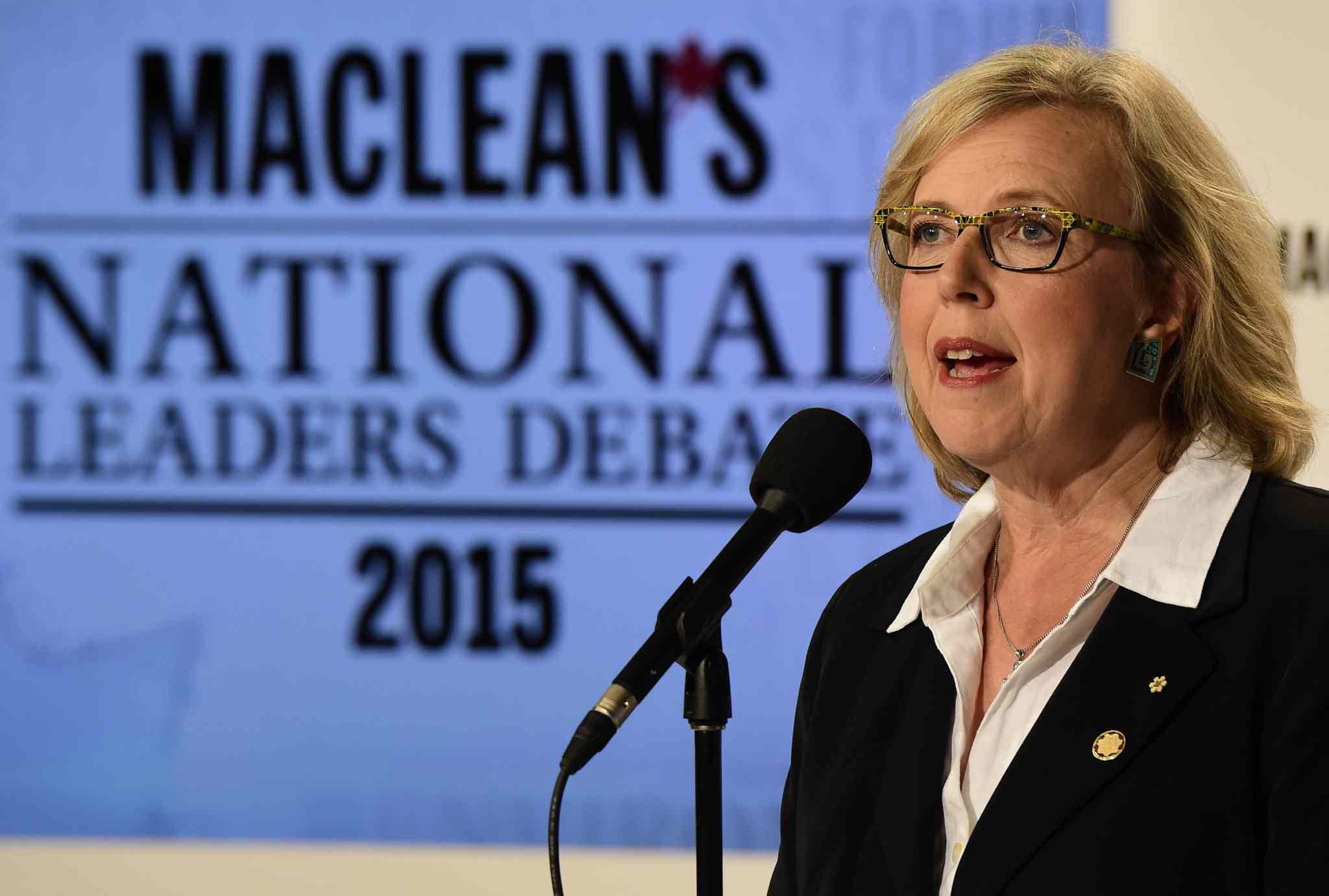 Green Party leader Elizabeth May speaks to members of the media after taking part in the first leaders' debate.