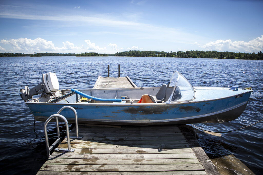 Rob Aitken's boat half full of water, holds down his dock on Saturday July 5 because of the high water and word that it was still rising at that point, something that is now a very common sight on Lake of the Woods these days.