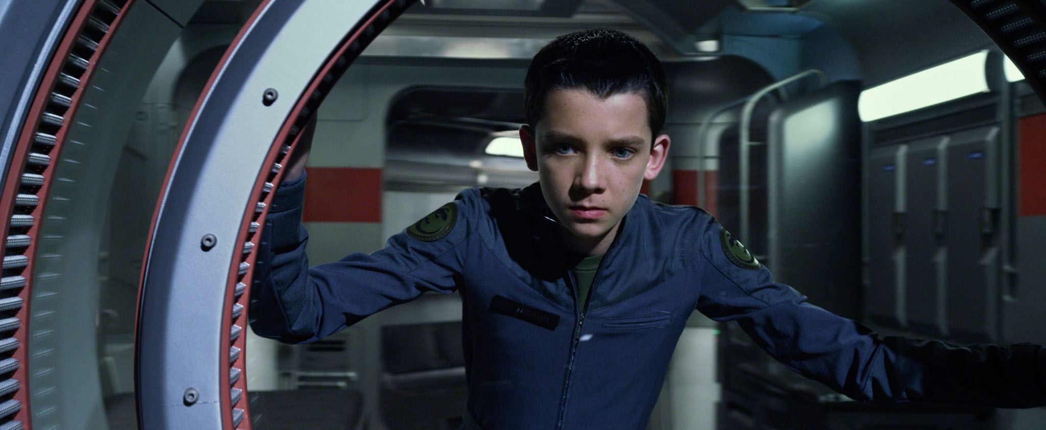 Asa Butterfield as Ender Wiggin (above and below left with Ford's gruff Graff) in Ender's Game.