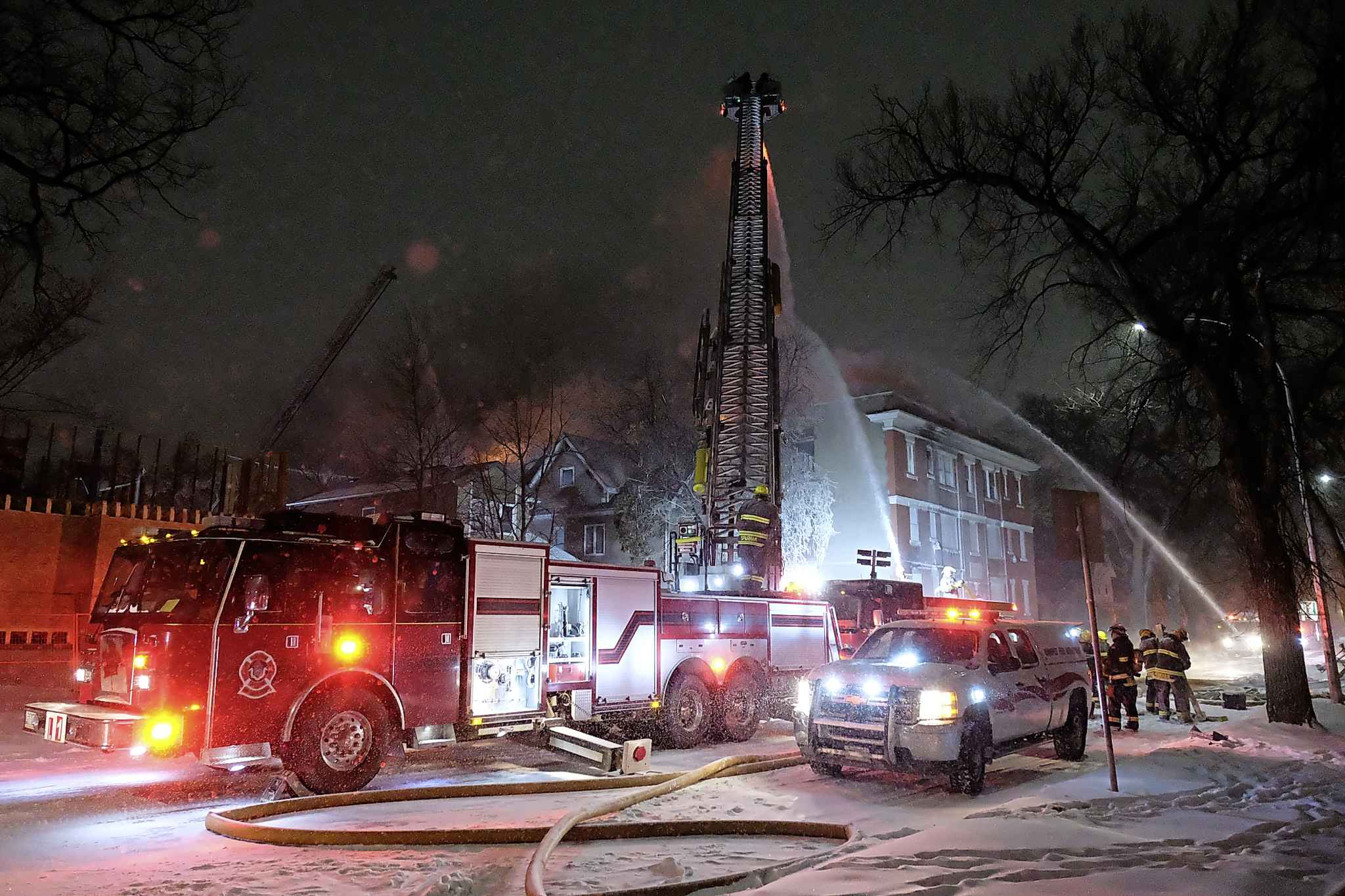 Firefighters battle the blaze at 426 Maryland St. on Wednesday evening.
