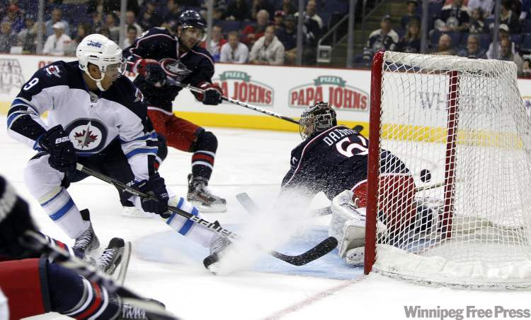 Evander Kane scores the first goal for the new-look Jets in Columbus Tuesday.