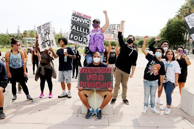 A group of peaceful protesters gather at Curtis Hixon Park to demand justice for victims of police brutality, Sunday, May 31, 2020, in downtown Tampa, Fla. (Douglas R. Clifford/Tampa Bay Times via AP)