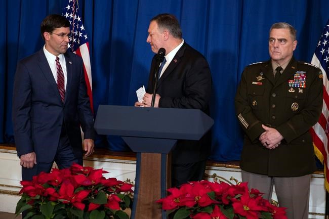 Secretary of State Mike Pompeo, center, Secretary of Defense Mark Esper, left, and Chairman of the Joint Chiefs of Staff Gen. Mark Milley deliver a statement on Iraq and Syria, at President Donald Trump's Mar-a-Lago property, Sunday, Dec. 29, 2019, in Palm Beach, Fla. (AP Photo/ Evan Vucci)