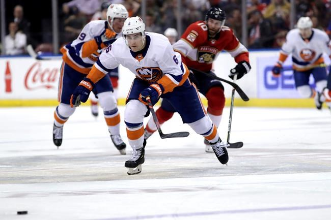 New York Islanders defenseman Ryan Pulock (6) and Florida Panthers right wing Brett Connolly (10) chase the puck during the second period of an NHL hockey game, Thursday, Dec. 12, 2019, in Sunrise, Fla. (AP Photo/Lynne Sladky)