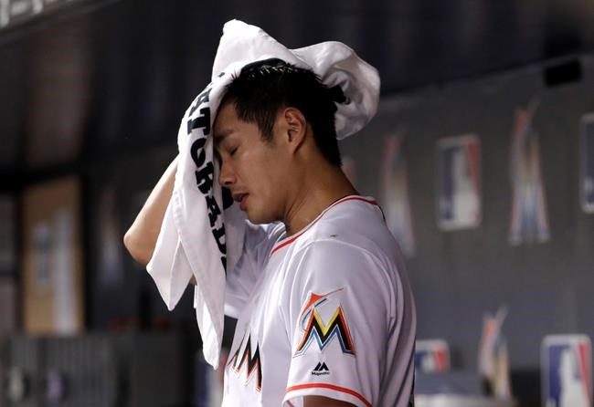 Miami Marlins starting pitcher Wei-Yin Chen wipes his face after bring relieved during the fifth inning of a baseball game against the San Francisco Giants, Monday, June 11, 2018, in Miami. (AP Photo/Lynne Sladky)