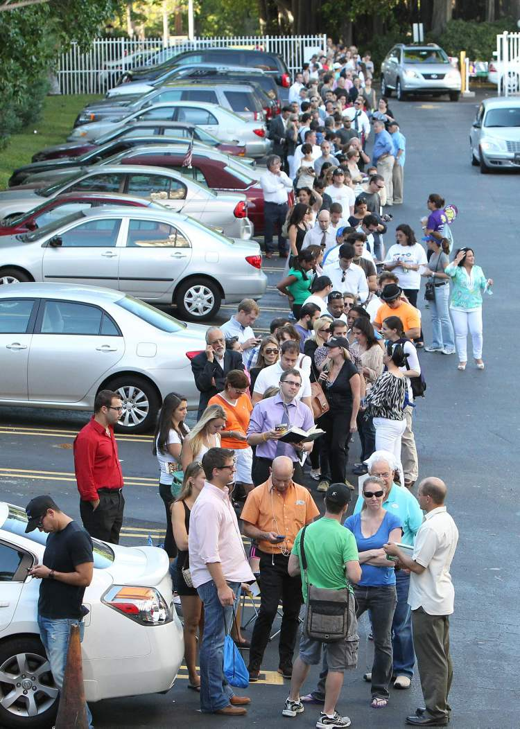 People wait in line to vote in Miami on Election Day Tuesday.  (David Santiago / The Associated Press)