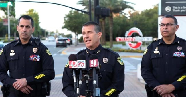 In this image made from video, Orlando Police Chief John Mina, center, speaks during a news conference, Monday, June 11, 2018, during a hostage standoff where a police officer was shot in Orlando, Fla. Police said a man suspected of battering his girlfriend wounded a police officer late Sunday and barricaded himself inside an apartment with several young children. (Red Huber/Orlando Sentinel via AP)