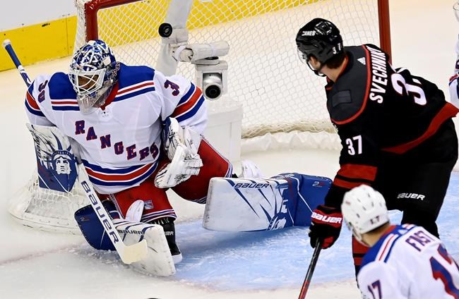 Carolina Hurricanes right wing Andrei Svechnikov (37) watches a goal on New York Rangers goaltender Henrik Lundqvist (30) as Rangers right wing Jesper Fast (17) looks on during first period NHL hockey action in Toronto, Saturday, Aug. 8, 2020. THE CANADIAN PRESS/Frank Gunn
