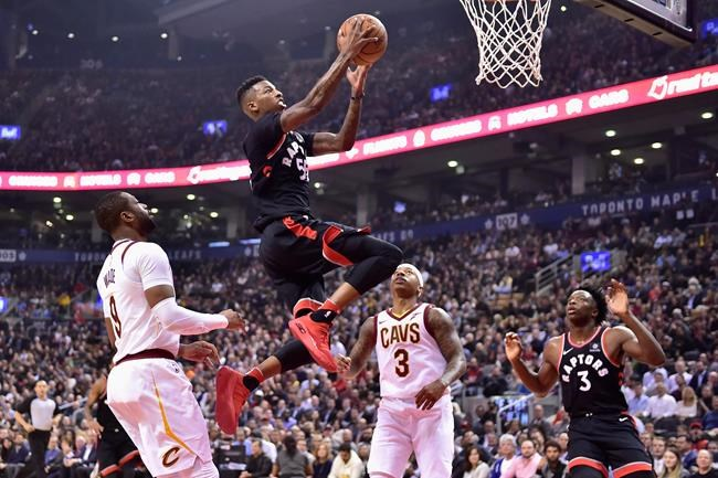 Toronto Raptors guard Delon Wright (55) goes up for a basket past Cleveland Cavaliers guard Dwyane Wade (9) and guard Isaiah Thomas (3) as Raptors forward OG Anunoby (3) looks on during first half NBA basketball action in Toronto on Thursday, January 11, 2018. THE CANADIAN PRESS/Frank Gunn