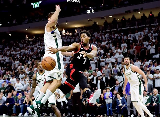 Toronto Raptors guard Kyle Lowry (7) passes the ball under pressure from Milwaukee Bucks forward Nikola Mirotic (41) during second half NBA Eastern Conference finals playoff basketball action in Milwaukee on Wednesday, May 15, 2019. THE CANADIAN PRESS/Frank Gunn