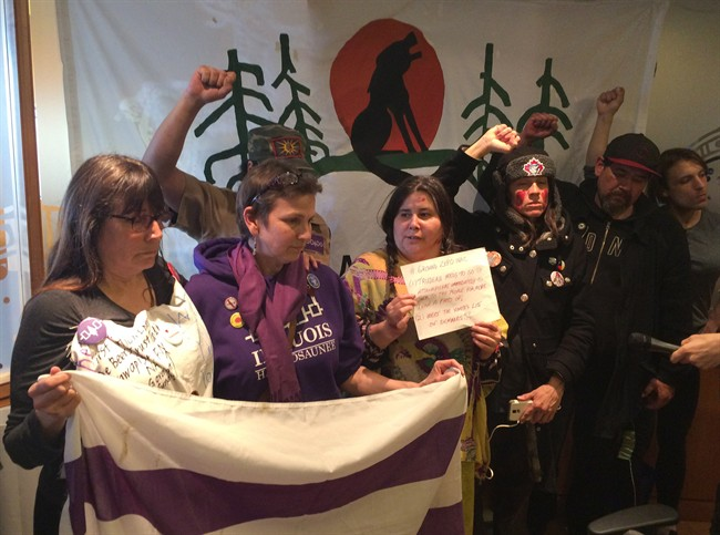 A group of activists for aboriginal rights are staging a sit-in at the Toronto offices of Indigenous and Northern Affairs Canada on Wednesday, April 13, 2016, in solidarity with a remote Ontario First Nation struggling with a suicide crisis. THE CANADIAN PRESS/Frank Gunn