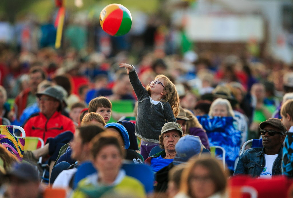 Kids play in the crowd on the opening day of Winnipeg Folk Fest 2014.