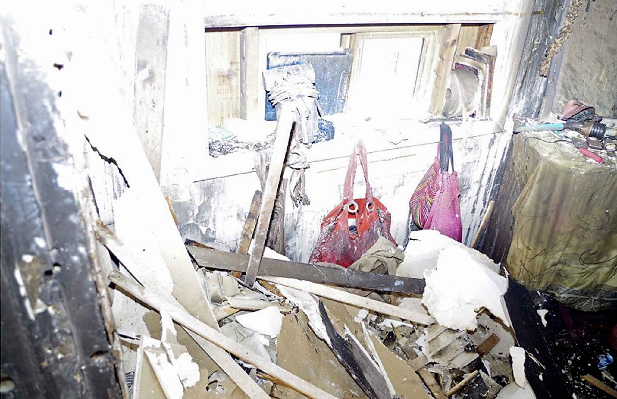 A photo from the trial shows Jeanenne  Fontaine's purses hanging on the wall in the bedroom of her Aberdeen Avenue home after the fire. (Winnipeg Free Press)