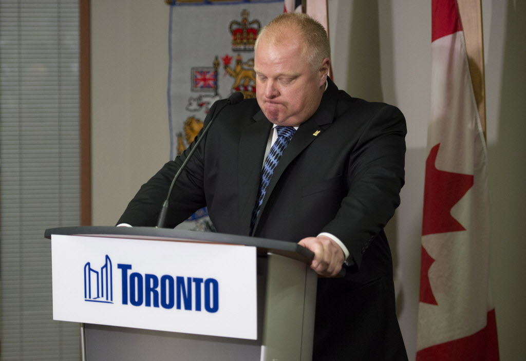Toronto Mayor Rob Ford holds back his emotions while speaking at a June 30 news conference.