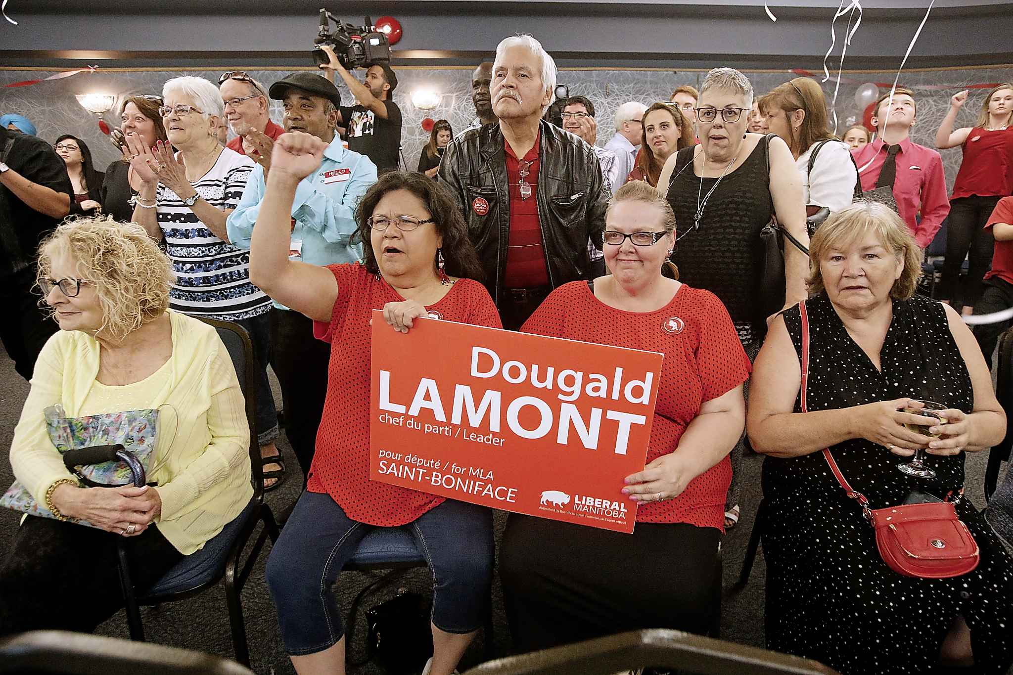 Supporters celebrate as they see positive results come in for Dougald Lamont, leader of the Manitoba Liberal Party, in the St. Boniface byelection Tuesday.