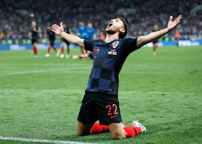 Croatia's Josip Pivaric celebrates after his team advanced to the final during the semifinal match between Croatia and England at the 2018 soccer World Cup in the Luzhniki Stadium in Moscow, Russia, Wednesday.