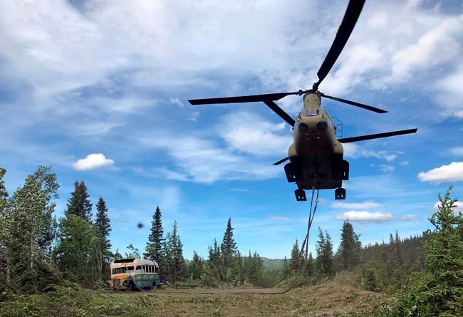 """FILE - In this June 18, 2020, file photo released by the Alaska National Guard, Alaska Army National Guard soldiers use a CH-47 Chinook helicopter to remove an abandoned bus, popularized by the book and movie """"Into the Wild,"""" out of its location in the Alaska backcountry. The state Department of Natural Resources said Thursday, July 30, that it intends to negotiate with the University of Alaska's Museum of the North in Fairbanks to display the bus. (Sgt. Seth LaCount/Alaska National Guard via AP, File)"""