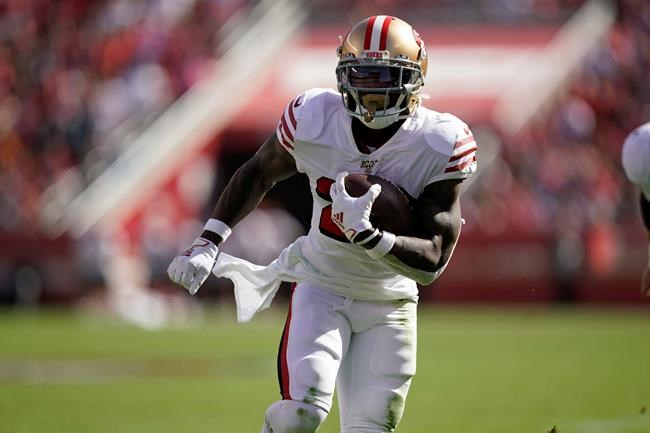 San Francisco 49ers running back Tevin Coleman runs with ball for a touchdown during the first half of an NFL football game against the Carolina Panthers Santa Clara, Calif., Sunday, Oct. 27, 2019. (AP Photo/Tony Avelar)