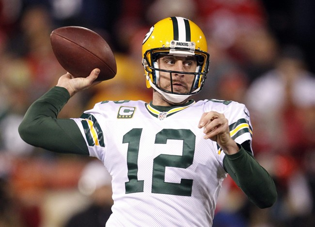 Green Bay Packers quarterback Aaron Rodgers (12) passes against the San Francisco 49ers during the first quarter of an NFC divisional playoff NFL football game in San Francisco, Saturday, Jan. 12, 2013. (AP Photo/Tony Avelar)