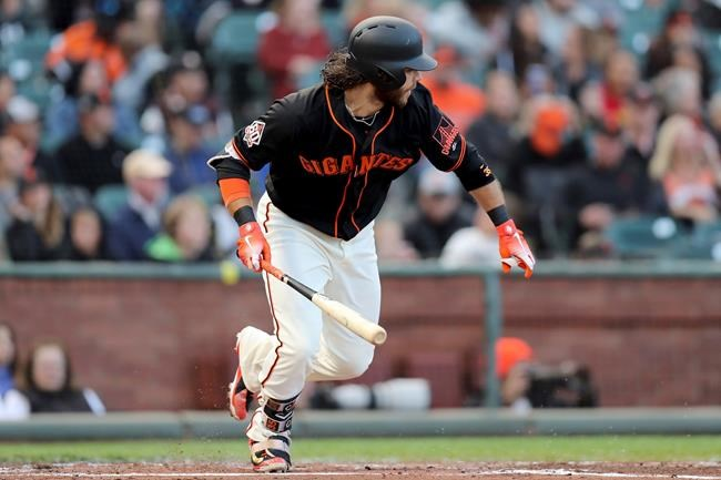 San Francisco Giants shortstop Brandon Crawford (35) singles in the second inning of a baseball game against the Colorado Rockies in San Francisco, Saturday, Sept. 15, 2018. (AP Photo/Scot Tucker)