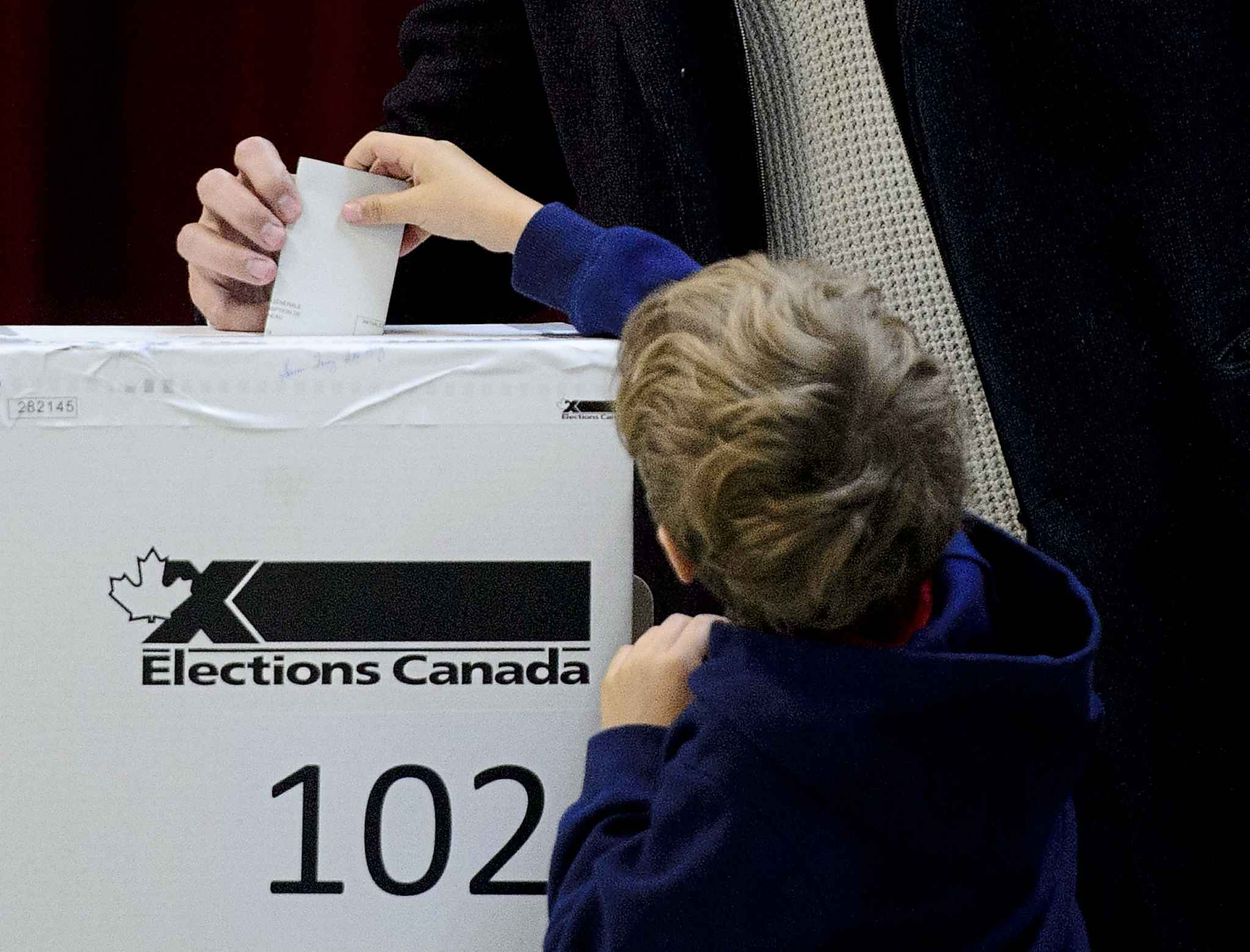 Federal elections in this country still rely on old-fashioned, marked paper ballots, manually inserted into ballot boxes, and then counted and tabulated by hand. (Sean Kilpatrick / Canadian Press files)