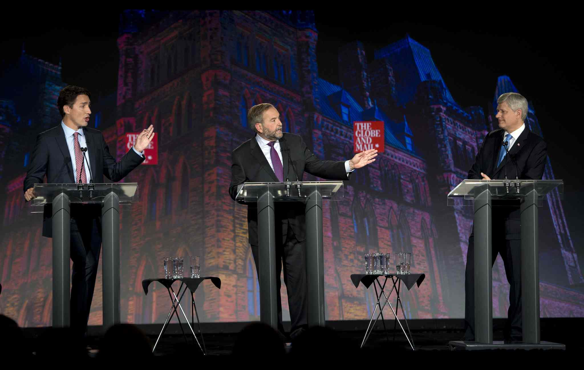 Liberal leader Justin Trudeau, left, NDP leader Tom Mulcair and Conservative leader Stephen Harper, right, take part in the Globe and Mail  leaders' debate Thursday, Sept. 17, 2015 in Calgary.