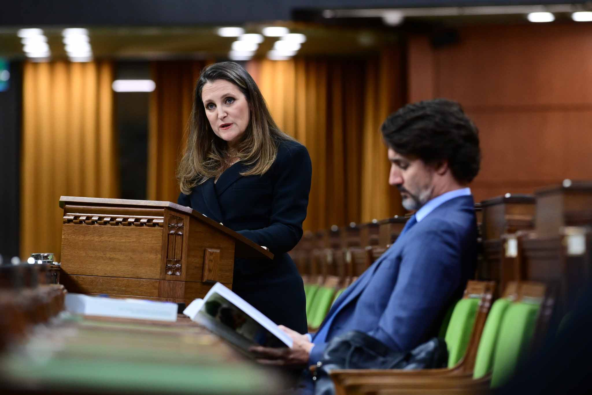 Freeland delivers the federal budget in the House of Commons as Prime Minister Justin Trudeau looks on in Ottawa on Monday.