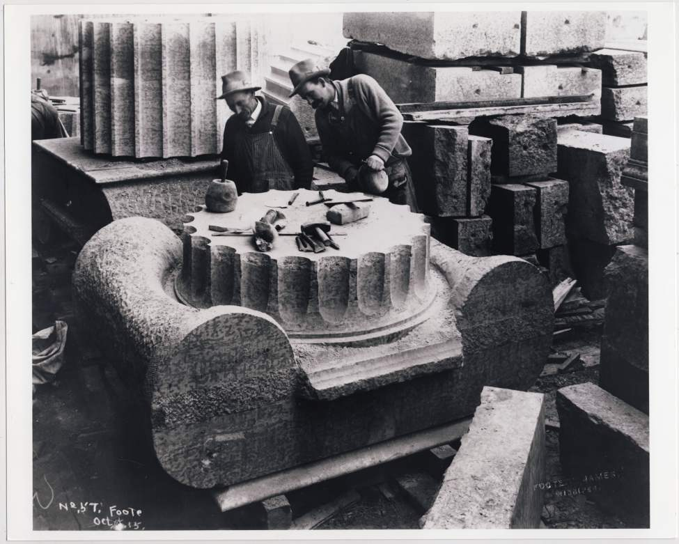 Stone masons work on what will be the top of a column made of limestone during construction of the Manitoba Legislative Building on October 5 1915.
