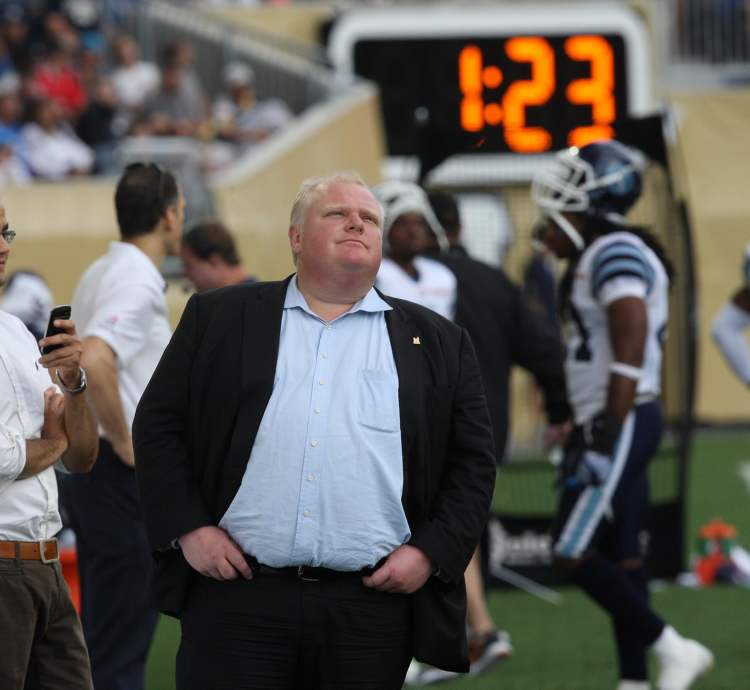 Toronto Mayor Rob Ford takes in the action and the atmosphere at Investors Group Field. (JOE BRYKSA / WINNIPEG FREE PRESS)