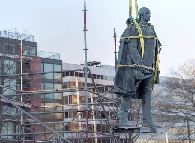 The federal government is asking an Indigenous group in Nova Scotia to recommend a new name for a Canadian Coast Guard ship that is currently named after a British military officer who called for the extermination of the Mi'kmaq people. Contractors remove the statue of Edward Cornwallis, a controversial historical figure, in a city park in Halifax on Wednesday, Jan. 31, 2018. Cornwallis, the military officer who founded Halifax in 1749, offered a cash bounty to anyone who killed a Mi'kmaw person. THE CANADIAN PRESS/Andrew Vaughan