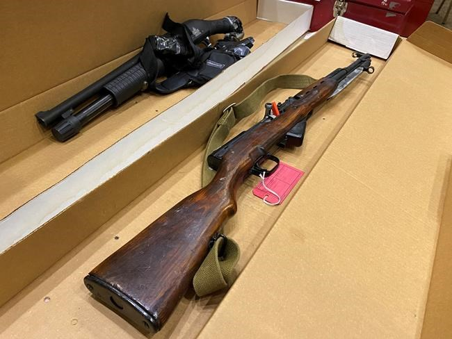 The SKS semi-automatic rifle and shotgun that were seized from the apartment of Matthew Raymond after his arrest are seen during a media access session to evidence on the first day of the trial at the Court of Queens Bench in Fredericton, N.B., Tuesday, Sept. 15, 2020. Two police officers and two civilians were killed on Aug 10, 2018. THE CANADIAN PRESS/Kevin Bissett