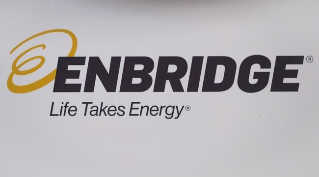 The Enbridge logo is shown at the company's annual meeting in Calgary on May 9, 2018. THE CANADIAN PRESS/Jeff McIntosh