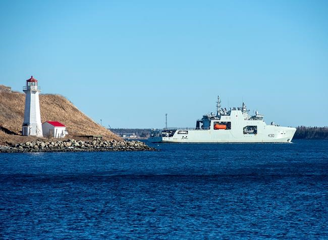 The Royal Canadian Navy is entering a new era today as it officially welcomes the long-overdue HMCS Harry deWolf into its fleet. The future HMCS Harry DeWolf, the navy's first Arctic and offshore patrol ship, built at the Irving-owned Halifax Shipyard, heads from the harbour in Halifax for sea trials on Friday, Jan. 31, 2020. THE CANADIAN PRESS/Andrew Vaughan