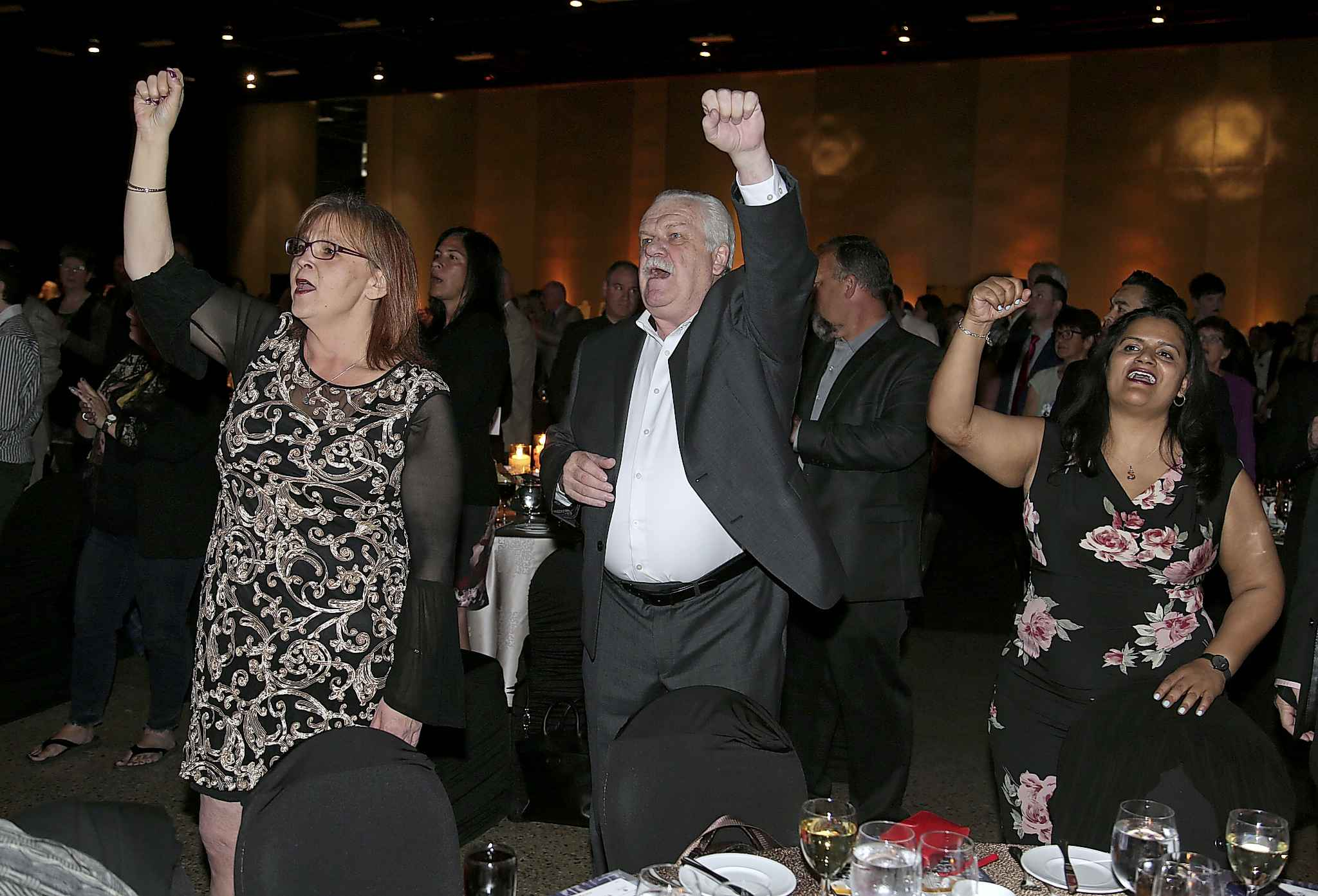 Marianne Hladun, left, Chris Aylward and Sharon DeSouza of PSAC sing along with a rendition of 'Solidarity Forever' at the Winnipeg General Strike Centennial Gala Dinner presented by Manitoba's unions Wednesday evening at the RBC Convention Centre Winnipeg.
