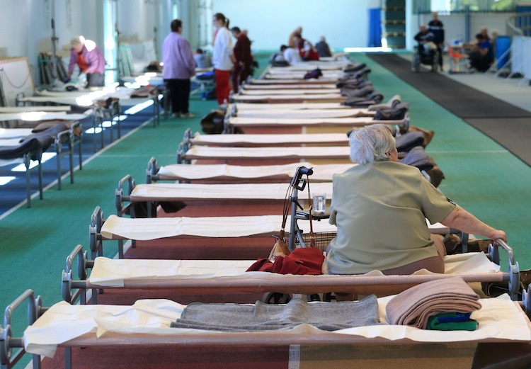 Emergency accommodations have been set up for those that have had to flee. This one is near Halle in eastern Germany. (Jens Wolf / The Associated Press)