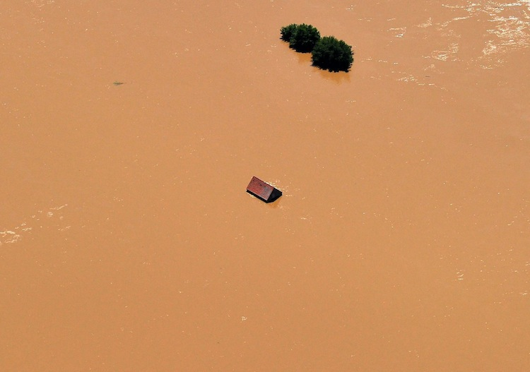 The roof of a house is visible above the swollen Elbe river near Meissen in the eastern portion of Germany. (Matthias Hiekel / The Associated Press)