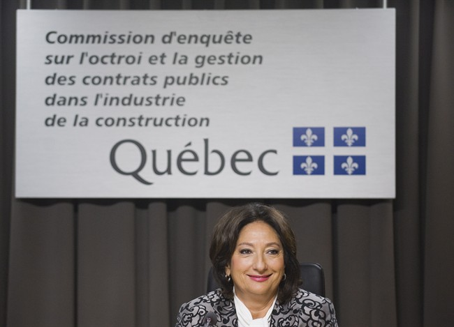Justice France Charbonneau smiles as she sits on the opening day Tuesday, May 22, 2012 of a Quebec inquiry looking into allegations of corruption in the province's construction industry in Montreal. THE CANADIAN PRESS/Graham Hughes